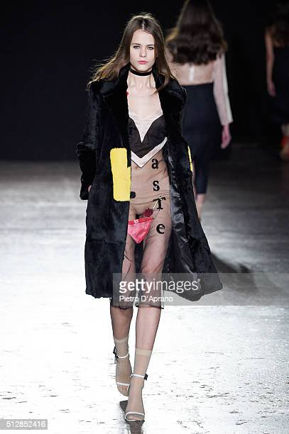 A model walks the runway at the Au Jour Le Jour show during Milan Fashion Week Fall/Winter 2016/17 on February 28 2016 in Milan Italy
