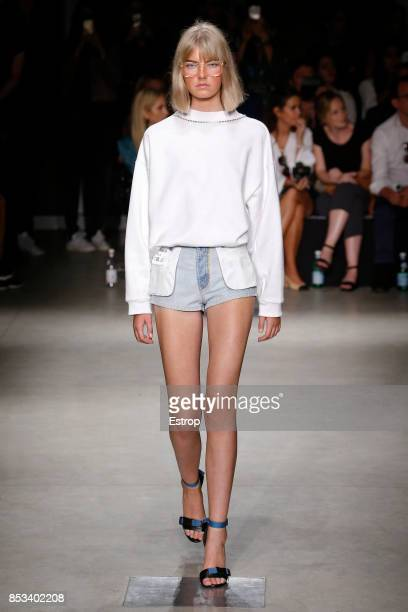 A model walks the runway at the Au Jour Le Jour show during Milan Fashion Week Spring/Summer 2018 on September 24 2017 in Milan Italy