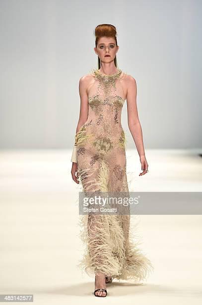 A model walks the runway at the Aurelio Costarella show during MercedesBenz Fashion Week Australia 2014 at Carriageworks on April 7 2014 in Sydney...