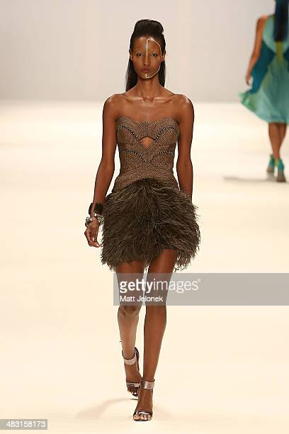 A model walks the runway at the Aurelio Costarella show during MercedesBenz Fashion Week Australia 2014 at Carriageworks on April 7 2014 in Sydney...