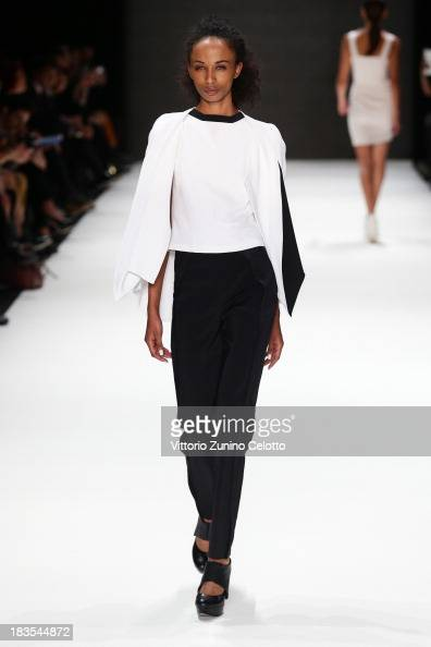 A model walks the runway at the Ayhan Yetgin show during MercedesBenz Fashion Week Istanbul s/s 2014 presented by American Express on October 7 2013...