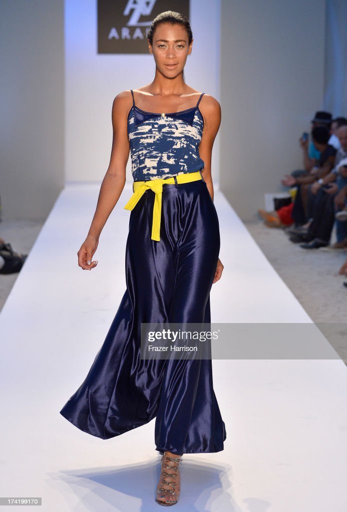 A model walks the runway at the A.Z. Araujo show during Mercedes-Benz Fashion Week Swim 2014 at Oasis at the Raleigh on July 21, 2013 in Miami, Florida.