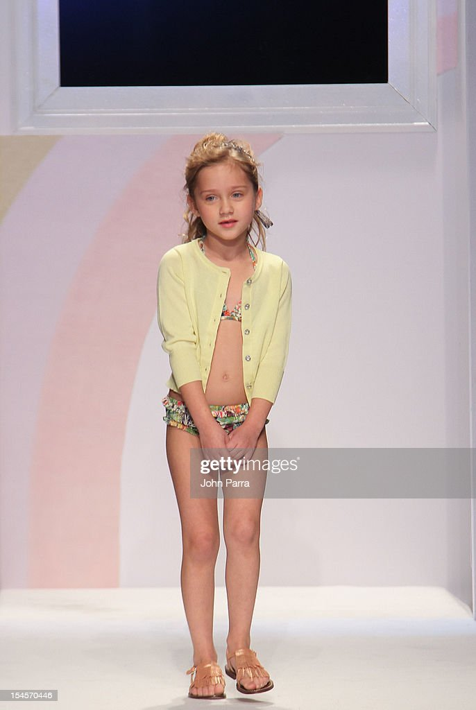 A model walks the runway at the Baby CZ show during the Swarovski Elements at Petite Parade NY Kids Fashion Week In Collaboration With VOGUEbambini - Day 2 at Industria Superstudio on October 21, 2012 in New York City.