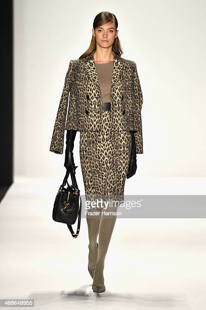 A model walks the runway at the Badgley Mischka fashion show during MercedesBenz Fashion Week Fall 2014 at The Theatre at Lincoln Center on February...