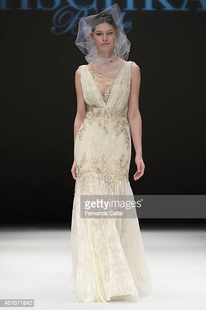 A model walks the runway at the Badgley Mischka Runway Show during Fall 2015 Bridal Collection at Pier 94 Fashion Theater on October 11 2014 in New...