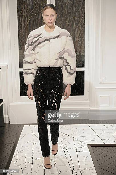 A model walks the runway at the Balenciaga Autumn Winter 2013 fashion show during Paris Fashion Week on February 28 2013 in Paris France