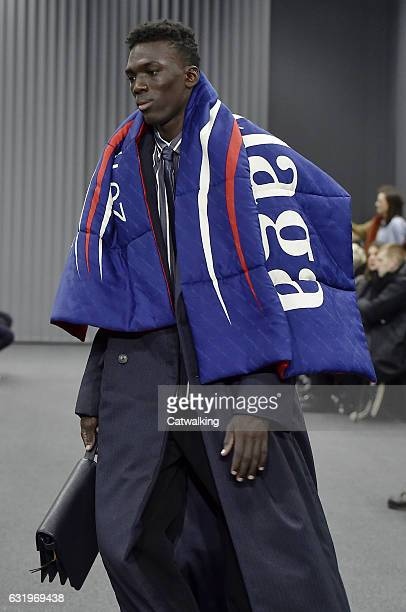 A model walks the runway at the Balenciaga Autumn Winter 2017 fashion show during Paris Menswear Fashion Week on January 18 2017 in Paris France