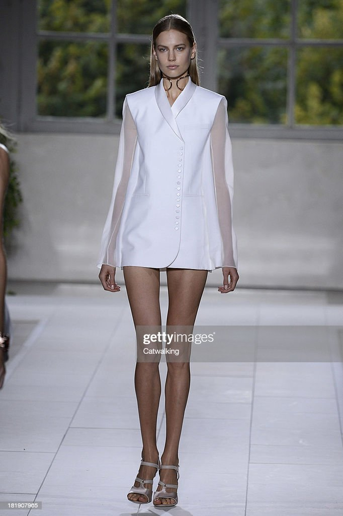 A model walks the runway at the Balenciaga Spring Summer 2014 fashion show during Paris Fashion Week on September 26, 2013 in Paris, France.