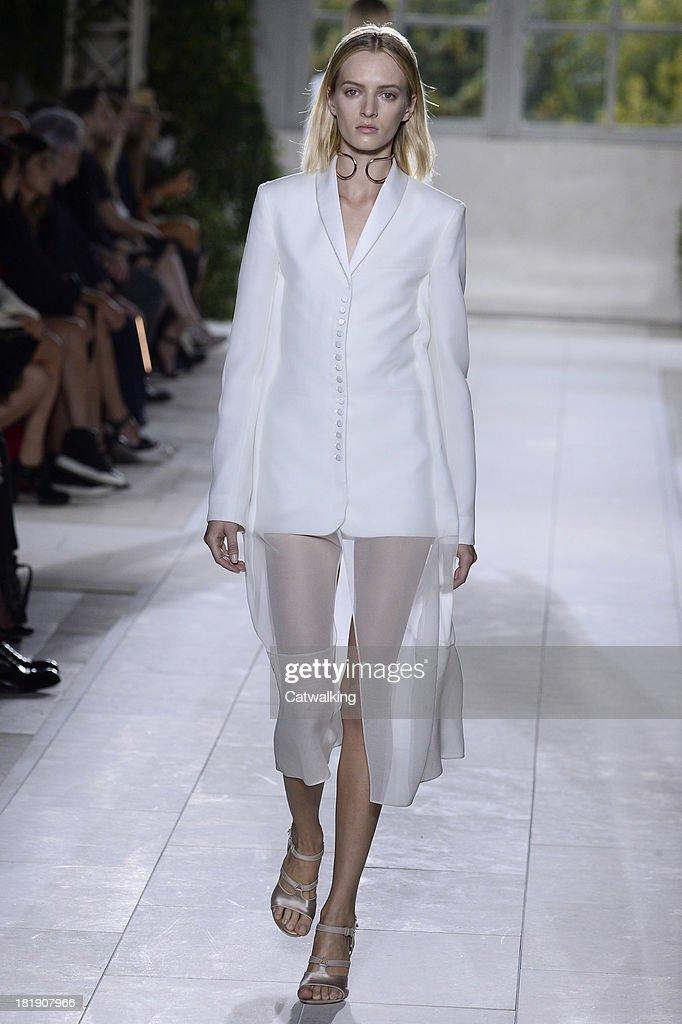 A model walks the runway at the Balenciaga Spring Summer 2014 fashion show during Paris Fashion Week on September 26, 2013 in Paris, France.