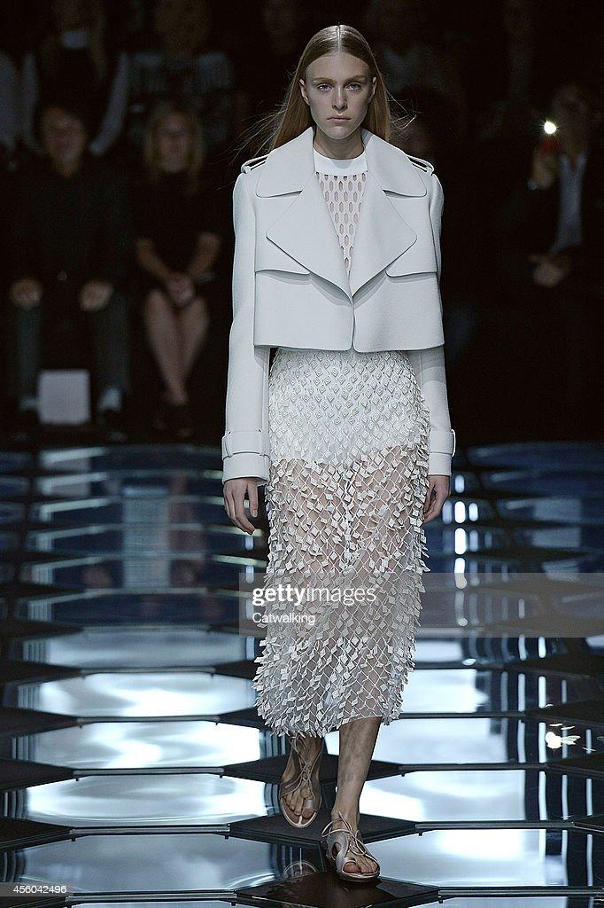 A model walks the runway at the Balenciaga Spring Summer 2015 fashion show during Paris Fashion Week on September 24 2014 in Paris France
