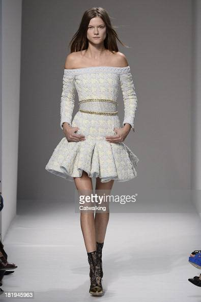 A model walks the runway at the Balmain Spring Summer 2014 fashion show during Paris Fashion Week on September 26 2013 in Paris France