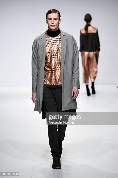 A model walks the runway at the Barre Noire show during the MercedesBenz Fashion Week Berlin Autumn/Winter 2015/16 at Brandenburg Gate on January 20...