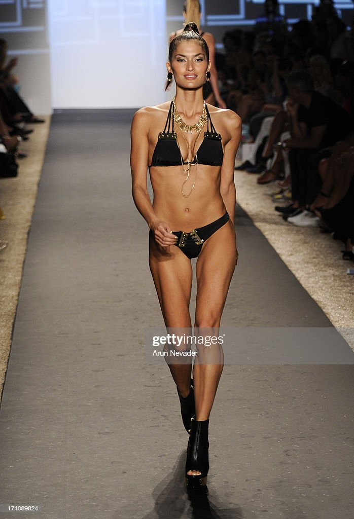 A model walks the runway at the Beach Bunny fashion show during Mercedes-Benz Fashion Week Swim 2014 - Runway at Cabana Grande at the Raleigh Hotel on July 19, 2013 in Miami, Florida.