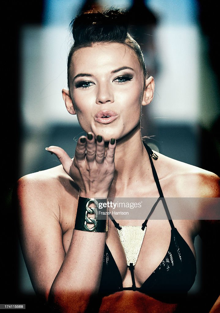 A model walks the runway at the Beach Bunny show during Mercedes-Benz Fashion Week Swim 2014 at Cabana Grande at the Raleigh on July 19, 2013 in Miami Beach, Florida.
