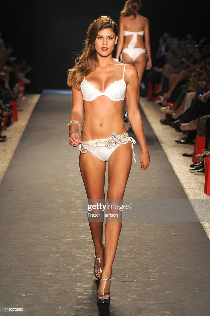A model walks the runway at the Beach Bunny Swimwear show during Merecdes-Benz Fashion Week Swim 2012 at The Raleigh on July 15, 2011 in Miami Beach, Florida.