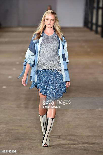 A model walks the runway at the Bec and Bridge show during MercedesBenz Fashion Week Australia 2014 at Blacksmith's Workshop Carriageworks on April 7...