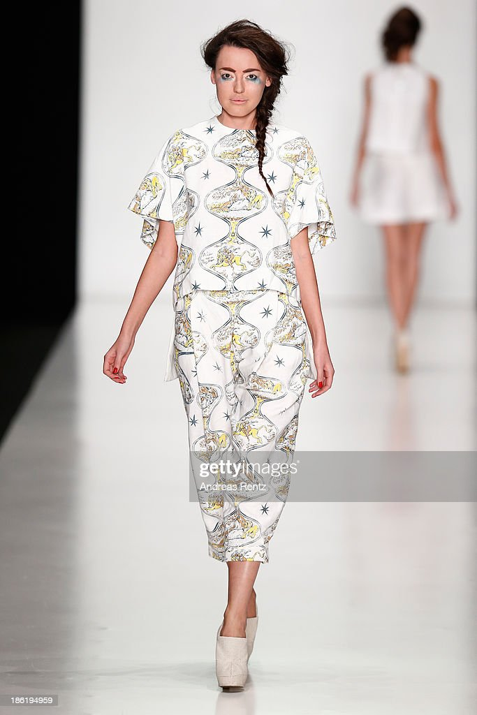 A model walks the runway at the Belarus Fashion Week Collective Show during Mercedes-Benz Fashion Week Russia S/S 2014 on October 29, 2013 in Moscow, Russia.