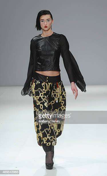 A model walks the runway at the Belle Sauvage show at the Fashion Scout venue during London Fashion Week AW14 at Freemasons Hall on February 15 2014...