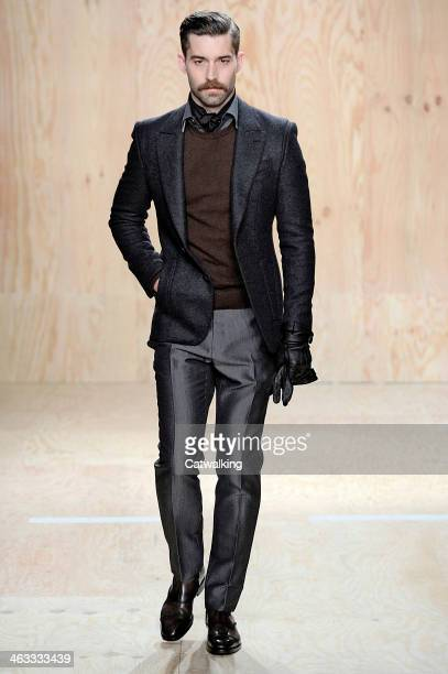 A model walks the runway at the Berluti Autumn Winter 2014 fashion show during Paris Menswear Fashion Week on January 17 2014 in Paris France