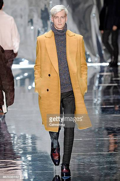 A model walks the runway at the Berluti Autumn Winter 2015 fashion show during Paris Menswear Fashion Week on January 23 2015 in Paris France