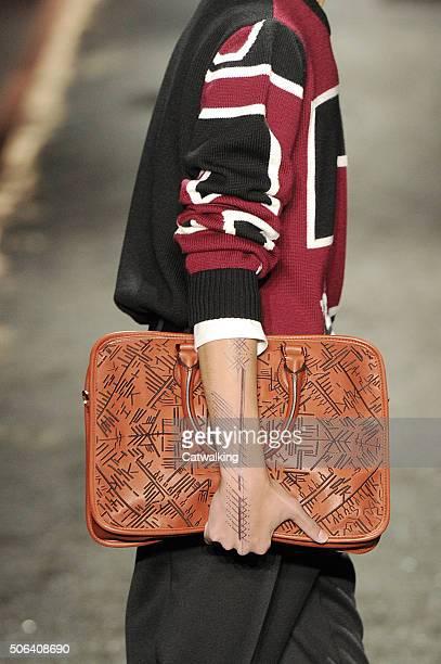 A model walks the runway at the Berluti Autumn Winter 2016 fashion show during Paris Menswear Fashion Week on January 22 2016 in Paris France