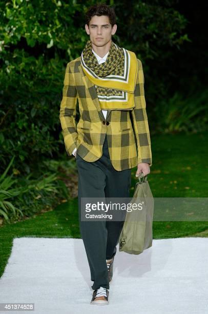 A model walks the runway at the Berluti Spring Summer 2015 fashion show during Paris Menswear Fashion Week on June 27 2014 in Paris France