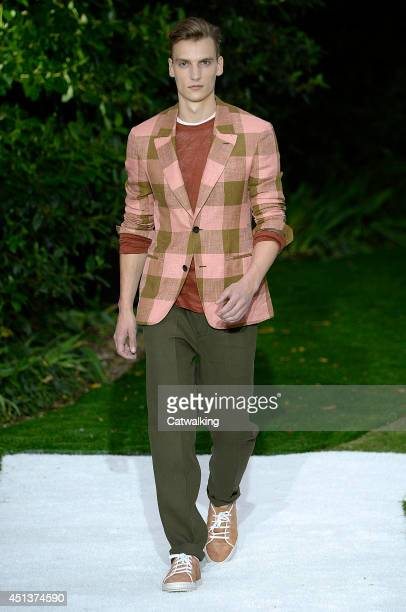 A model walks the runway at the Berluti Spring Summer 2015 fashion show during Paris Menswear Fashion Week on June 27 2014 in Paris France