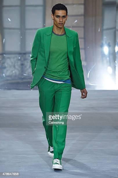 A model walks the runway at the Berluti Spring Summer 2016 fashion show during Paris Menswear Fashion Week on June 26 2015 in Paris France