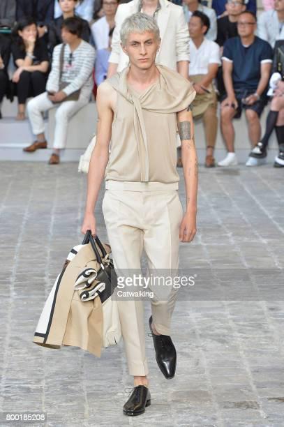 A model walks the runway at the Berluti Spring Summer 2018 fashion show during Paris Menswear Fashion Week on June 23 2017 in Paris France