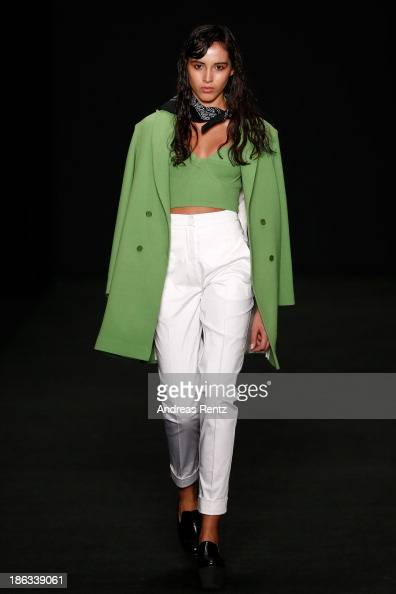A model walks the runway at the BEssARION show during MercedesBenz Fashion Week Russia S/S 2014 on October 30 2013 in Moscow Russia