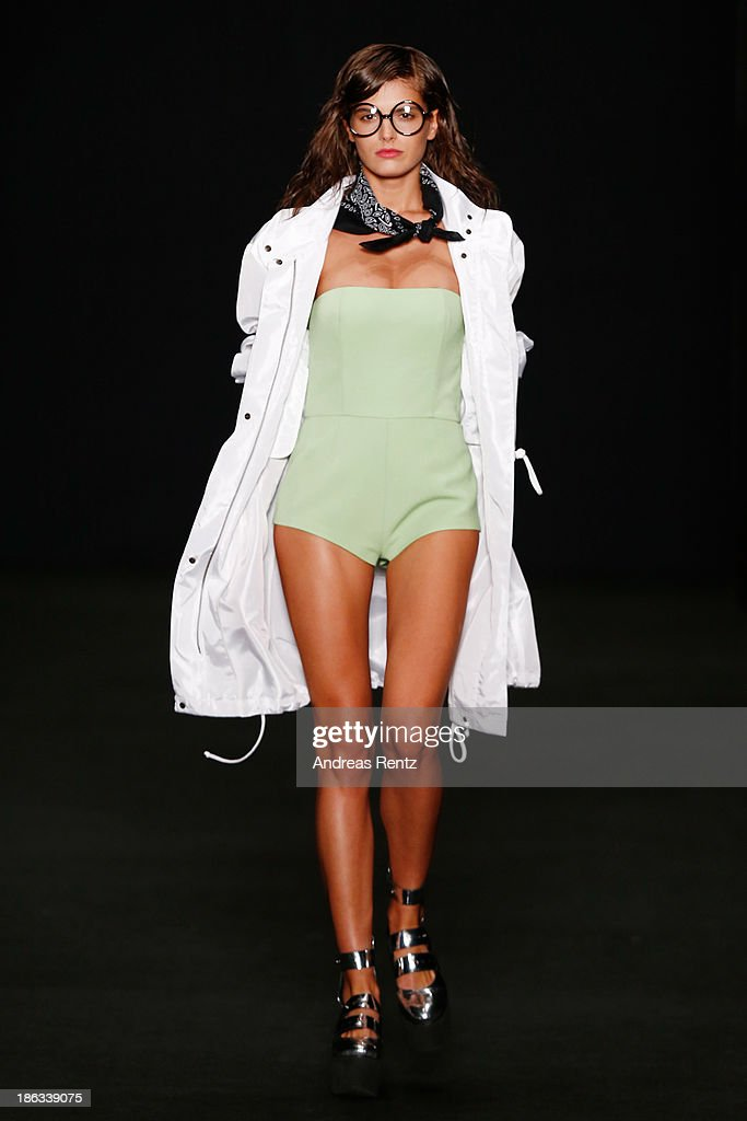 A model walks the runway at the BEssARION show during Mercedes-Benz Fashion Week Russia S/S 2014 on October 30, 2013 in Moscow, Russia.