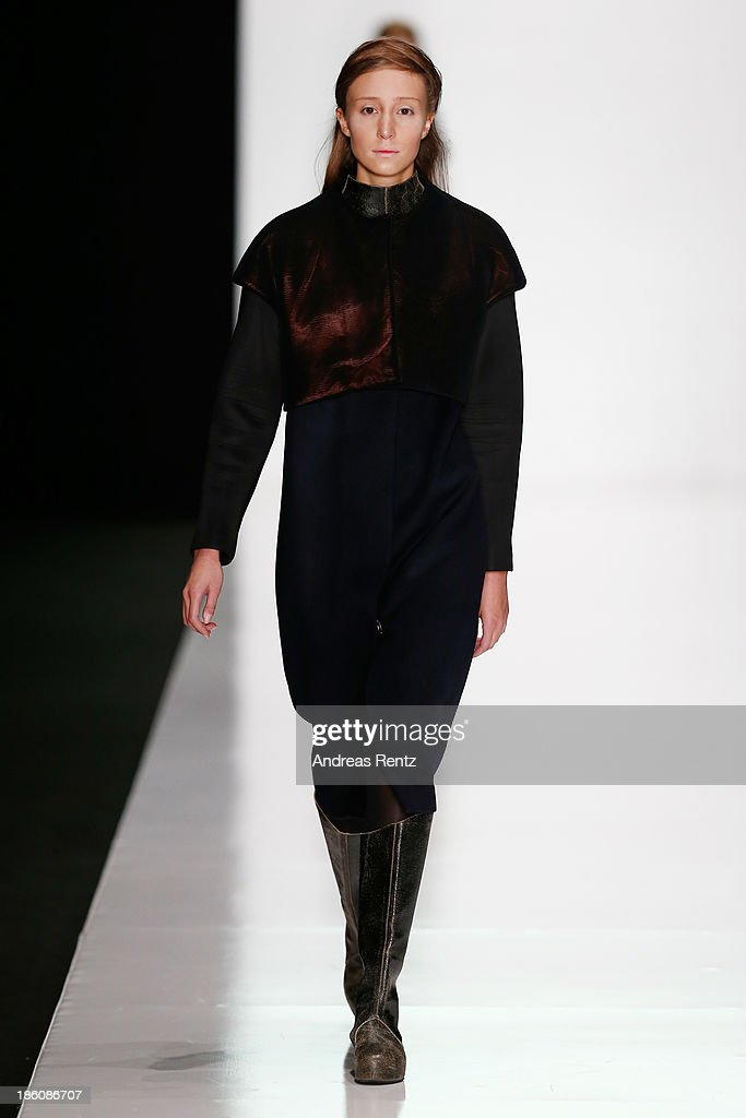 A model walks the runway at the Best Collections of BHSAD 'Fashion Design' Course show during Mercedes-Benz Fashion Week Russia S/S 2014 on October 28, 2013 in Moscow, Russia.