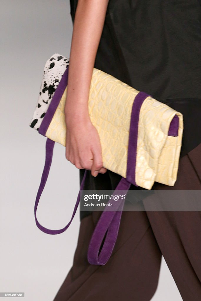A model (detail) walks the runway at the Best Collections of BHSAD 'Fashion Design' Course show during Mercedes-Benz Fashion Week Russia S/S 2014 on October 28, 2013 in Moscow, Russia.