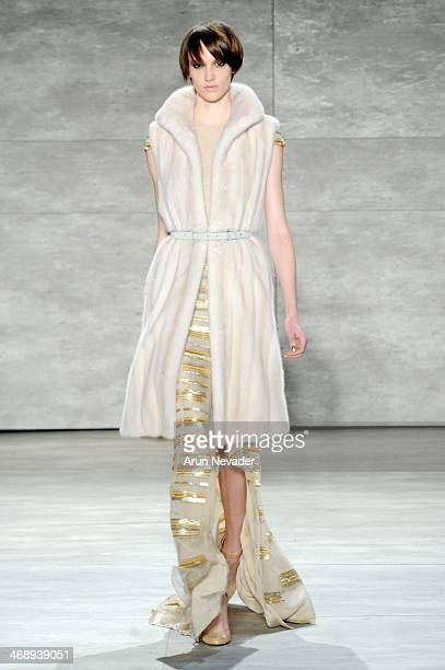 A model walks the runway at the Bibhu Mohapatra fashion show during MercedesBenz Fashion Week Fall 2014 at The Pavilion at Lincoln Center on February...