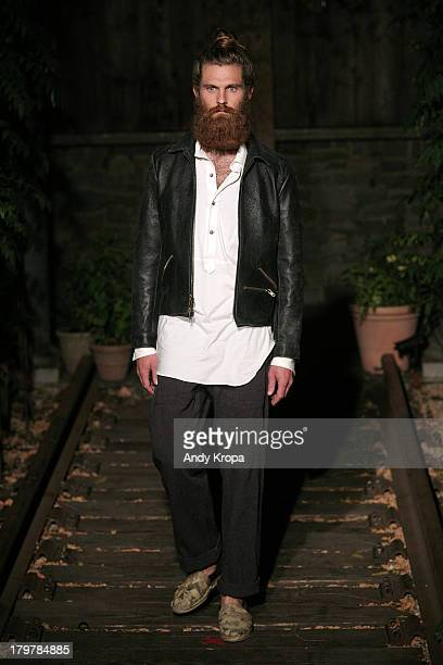 A model walks the runway at the Billy Reid fashion show during MercedesBenz Fashion Week Spring 2014 at The McKittrick Hotel on September 6 2013 in...