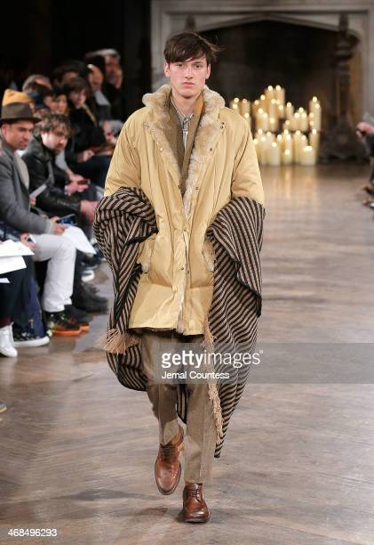 A model walks the runway at the Billy Reid Men's fashion show during MercedesBenz Fashion Week Fall 2014 at The Highline Hotel on February 10 2014 in...