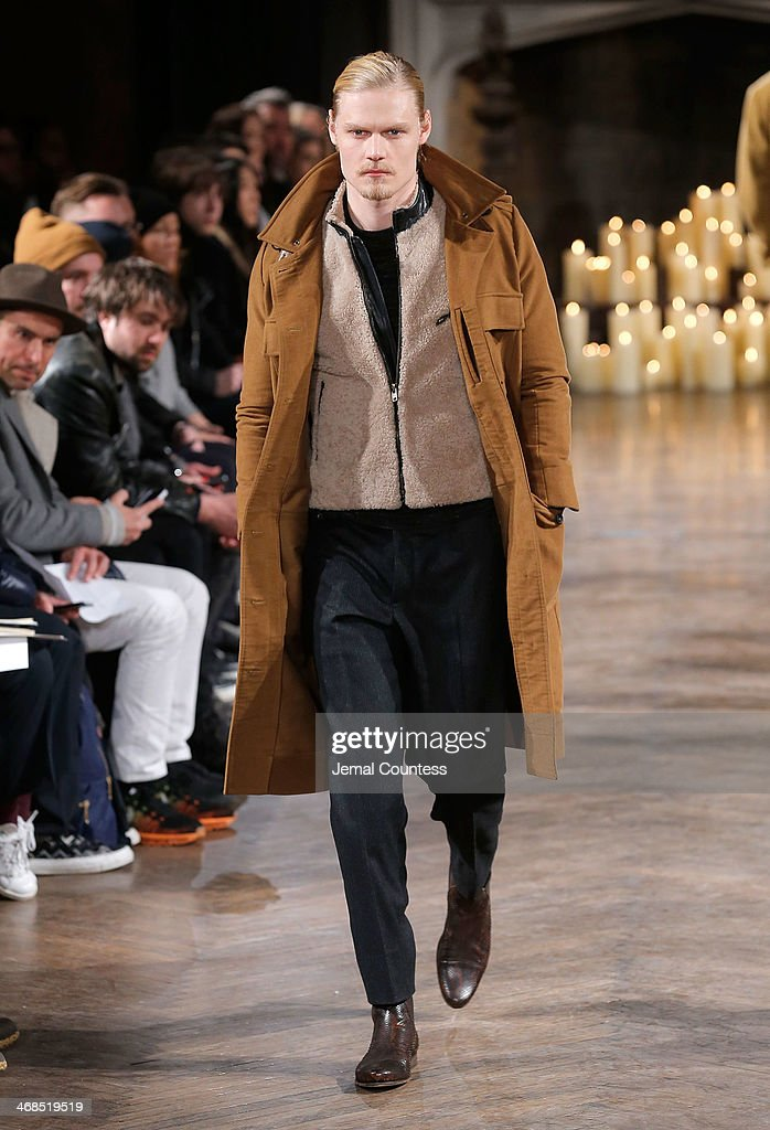 A model walks the runway at the Billy Reid Men's fashion show during Mercedes-Benz Fashion Week Fall 2014 at The Highline Hotel on February 10, 2014 in New York City.