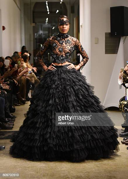 A model walks the runway at the Binzario Couture show during Fall 2016 New York Fashion Week at the Prince George Gallery on February 11 2016 in New...