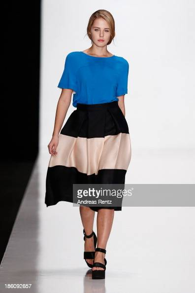 A model walks the runway at the Biryzkov show during MercedesBenz Fashion Week Russia S/S 2014 on October 28 2013 in Moscow Russia
