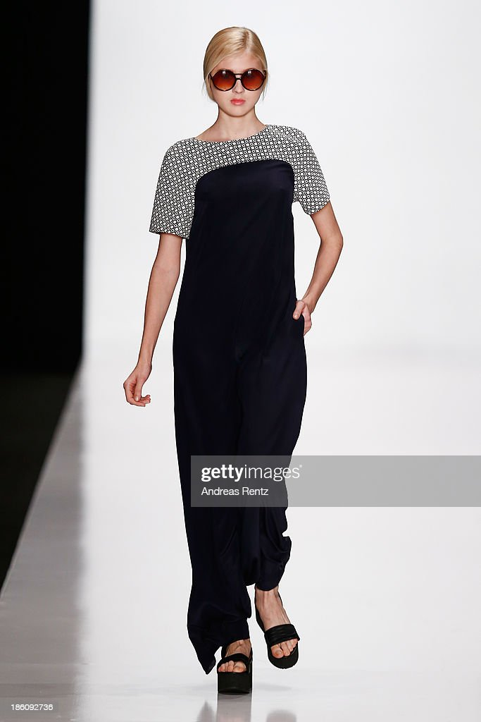A model walks the runway at the Biryzkov show during Mercedes-Benz Fashion Week Russia S/S 2014 on October 28, 2013 in Moscow, Russia.