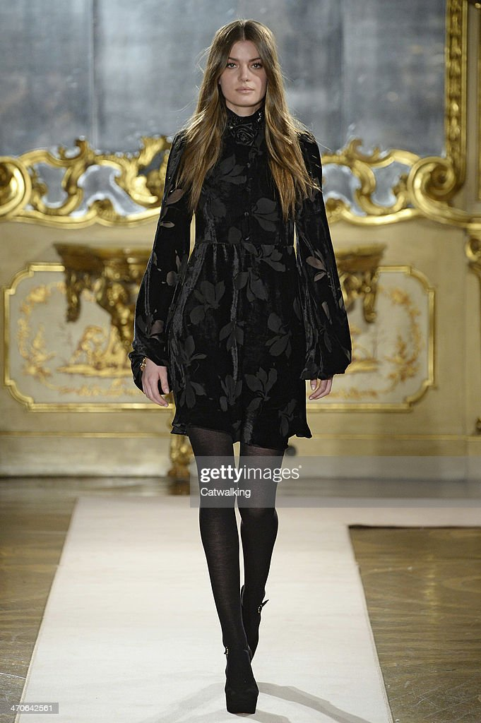 A model walks the runway at the Blugirl Autumn Winter 2014 fashion show during Milan Fashion Week on February 20, 2014 in Milan, Italy.