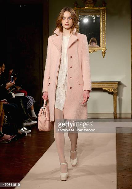 A model walks the runway at the Blugirl Show during Milan Fashion Week Womenswear Autumn/Winter 2014 on February 20 2014 in Milan Italy