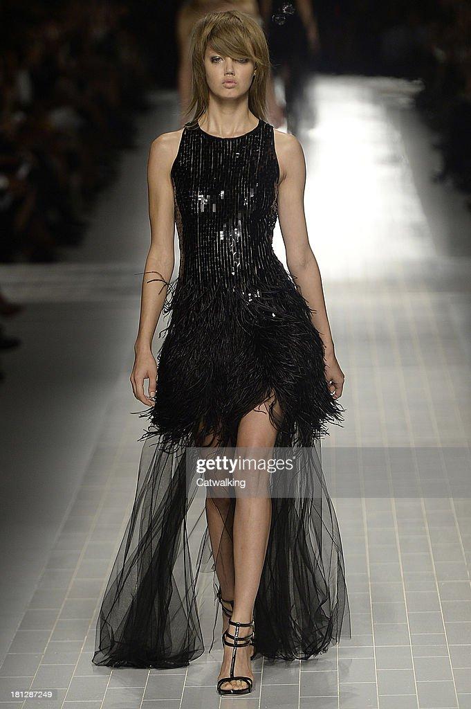 A model walks the runway at the Blumarine Spring Summer 2014 fashion show during Milan Fashion Week on September 20, 2013 in Milan, Italy.