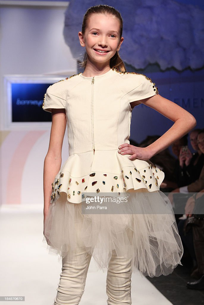 A model walks the runway at the Bonnie Young show during the Swarovski Elements at Petite Parade NY Kids Fashion Week In Collaboration With VOGUEbambini - Day 2 at Industria Superstudio on October 21, 2012 in New York City.