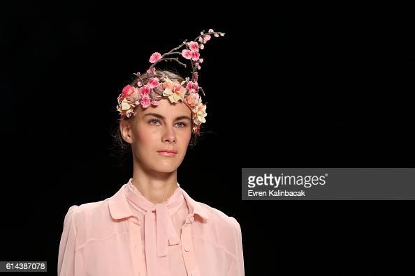 A model walks the runway at the Bora Aksu show during MercedesBenz Fashion Week Istanbul at Zorlu Center on October 13 2016 in Istanbul Turkey