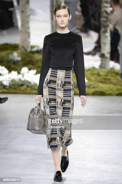 A model walks the runway at the Boss Autumn Winter 2014 fashion show during New York Fashion Week on February 12 2014 in New York United States