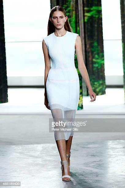 A model walks the runway at the Boss fashion show during MercedesBenz Fashion Week Spring on September 10 2014 in New York City