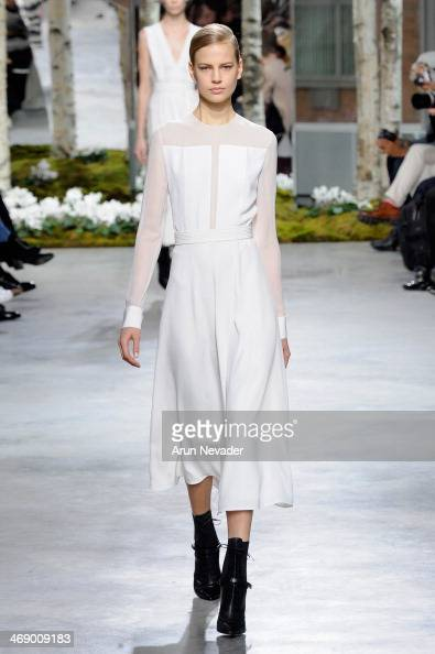 A model walks the runway at the Boss Women fashion show during MercedesBenz Fashion Week Fall 2014 at Skylight Limited on February 12 2014 in New...