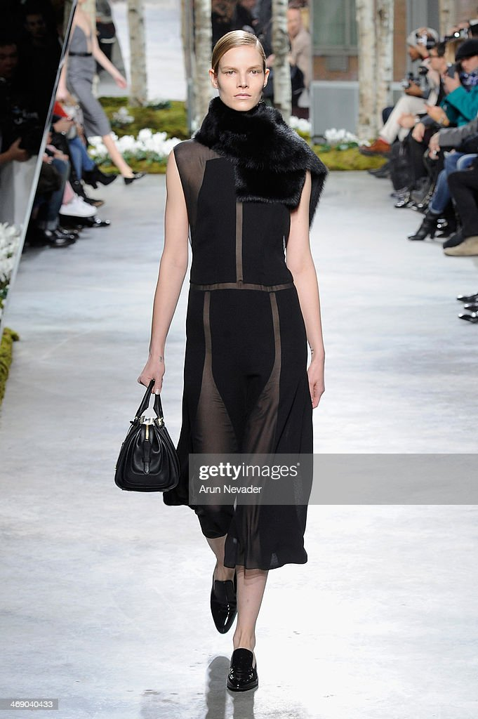 A model walks the runway at the Boss Women fashion show during Mercedes-Benz Fashion Week Fall 2014 on February 12, 2014 in New York City.