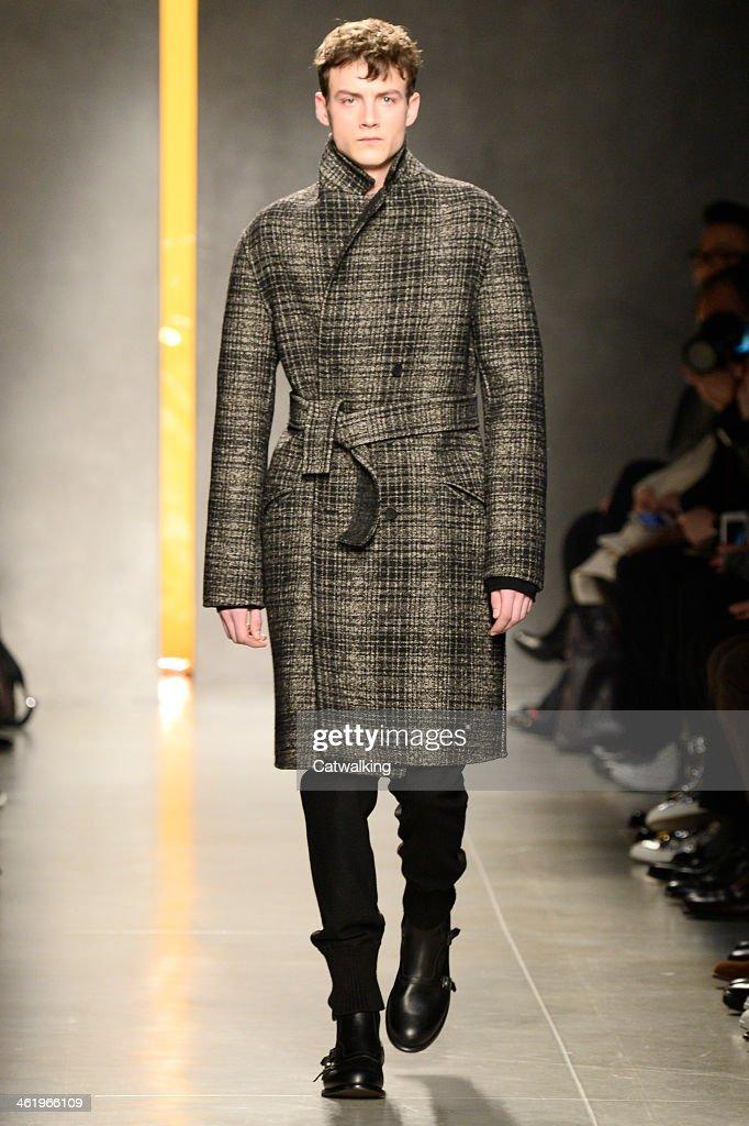 A model walks the runway at the Bottega Veneta Autumn Winter 2014 fashion show during Milan Menswear Fashion Week on January 12, 2014 in Milan, Italy.